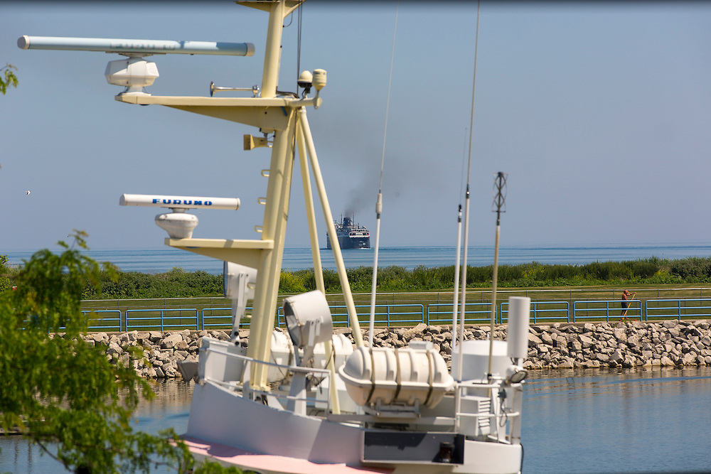 The SS Badger ferry heads out of Manitowoc, Wisconsin on it's 60 mile trip across Lake Michigan to Ludington, Michigan.  Photo by Mike Roemer
