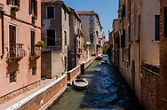 VIew of a quiet canal on a warm summer day in Venice, Italy