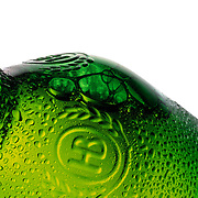 Glass bottle showing condensation on the outside and bubbles on the inside Ray Massey is an established, award winning, UK professional  photographer, shooting creative advertising and editorial images from his stunning studio in a converted church in Camden Town, London NW1. Ray Massey specialises in drinks and liquids, still life and hands, product, gymnastics, special effects (sfx) and location photography. He is particularly known for dynamic high speed action shots of pours, bubbles, splashes and explosions in beers, champagnes, sodas, cocktails and beverages of all descriptions, as well as perfumes, paint, ink, water – even ice! Ray Massey works throughout the world with advertising agencies, designers, design groups, PR companies and directly with clients. He regularly manages the entire creative process, including post-production composition, manipulation and retouching, working with his team of retouchers to produce final images ready for publication.
