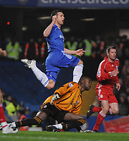 Photo: Tony Oudot/Sportsbeat Images.<br /> Chelsea v Liverpool. Carling Cup, Quarter Final. 19/12/2007.<br /> Frank Lampard of Chelsea sees his shot saved by Liverpool goalkeeper Charles Itandje