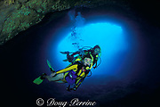 divers explore cave formed by <br /> submerged lava tube, south shore<br /> Oahu, Hawaii, USA ( Pacific ) MR 288-289