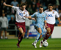 Photo: Steve Bond.<br /> Coventry City v West Ham United. Carling Cup. 30/10/2007. Michael Mifsud (C) attacking. Defenders George McCartney (L) & Hayden Mullins (R)
