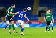 Cardiff City's Mark Harris (29) under pressure from Birmingham City's Harlee Dean (12) during the EFL Sky Bet Championship match between Cardiff City and Birmingham City at the Cardiff City Stadium, Cardiff, Wales on 16 December 2020.