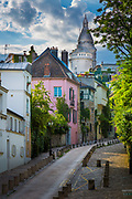 Montmartre is a hill (the butte Montmartre) which is 130 metres high, giving its name to the surrounding district, in the north of Paris in the 18th arrondissement, a part of the Right Bank. Montmartre is primarily known for the white-domed Basilica of the Sacré Cœur on its summit and as a nightclub district. The other, older, church on the hill is Saint Pierre de Montmartre, which claims to be the location at which the Jesuit order of priests was founded. Many artists had studios or worked around the community of Montmartre such as Salvador Dalí, Amedeo Modigliani, Claude Monet, Piet Mondrian, Pablo Picasso and Vincent van Gogh. Montmartre is also the setting for several hit films. This site is served by metro line 2 stations of Anvers, Pigalle and Blanche and the line 12 stations of Pigalle, Abbesses, Lamarck - Caulaincourt and Jules Joffrin.