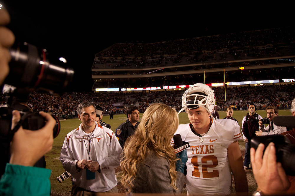 Colt McCoy, quarterback #12, during on-field post-game interview with Erin Andrews of ESPN. Texas Longhorns at Texas A&M Aggies. Photographed at Kyle Field in College Station, Texas on Thursday, November 26 2009. Photograph © 2009 Darren Carroll