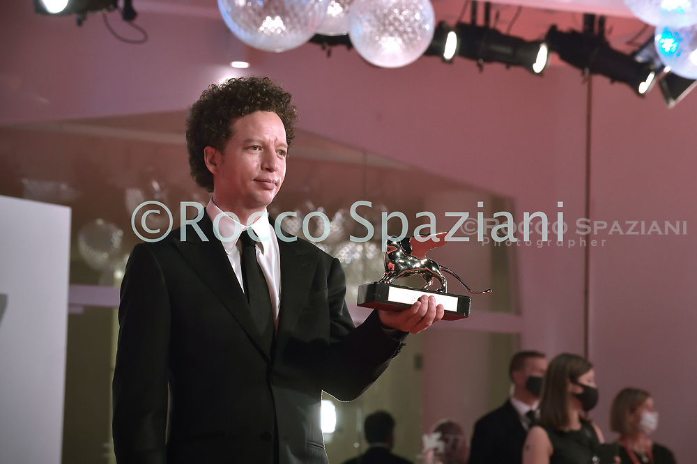 VENICE, ITALY - SEPTEMBER 12: Michel Franco poses with the Silver Lion - Award for Best Director during the winners photocall at the 77th Venice Film Festival on September 12, 2020 in Venice, Italy. <br /> (Photo by Rocco Spaziani)