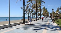 Mediterranean facing promenade, lined with palm trees, San Pedro de Alcantara, Marbella, Spain, March 2014. 201403263092<br />