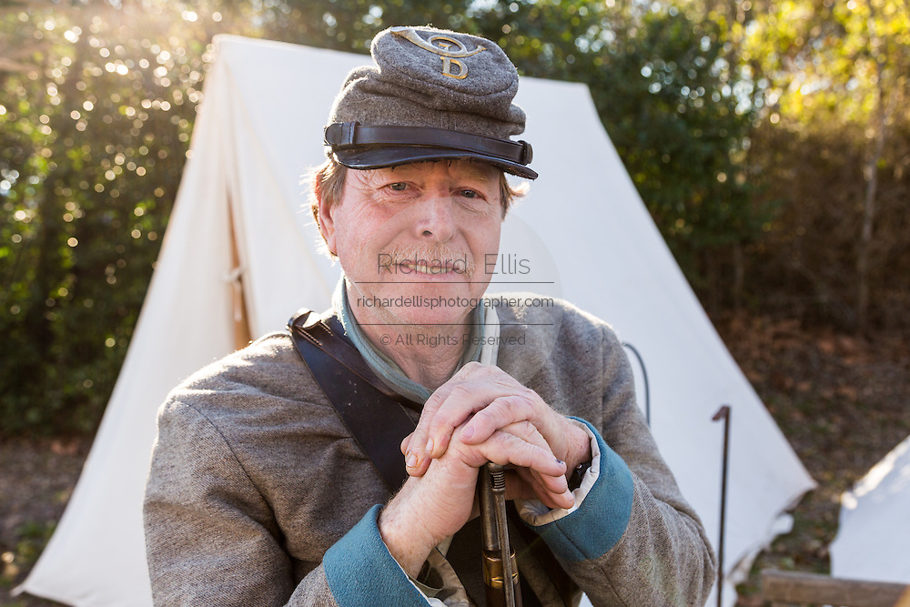 A Confederate history re-enactor at his camp to mark the 150th anniversary of the Confederate submarine H.L. Hunley February 15, 2014 in Charleston, South Carolina. On February 17, 1864 the H.L. Hunley attacked the Union ship U.S.S. Housatonic and became the first combat sub to sink an enemy warship, but it also mysteriously sunk soon after the attack, killing the entire eight-man crew.