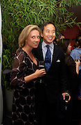 Teddy Wong and Zoe Appleyard, Party given by California Wine to celebrate wines from the Golden state,  hosted by Natasha McElhone, Emily Oppenheimer and Dr. Martin Kelly at the old Saatchi Gallery, 8 October 2003. © Copyright Photograph by Dafydd Jones 66 Stockwell Park Rd. London SW9 0DA Tel 020 7733 0108 www.dafjones.com