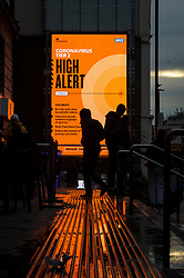 © Licensed to London News Pictures. 09/12/2020. LONDON, UK.  Covid-19 digital signage near London Bridge.  London is currently in Tier 2 High Alert level, but it is reported that the city may move to Tier 3 Very High Alert level before Christmas as infections continue to rise across the capital.  Photo credit: Stephen Chung/LNP