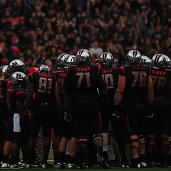 Oct 6, 2012: Rutgers Scarlet Knights huddle during second half NCAA college football action between the Rutgers Scarlet Knights and UConn Huskies at High Point Solutions Stadium in Piscataway, N.J.