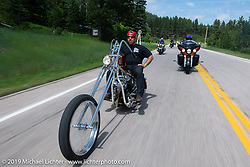 Carlos Amador of Daily Driver Choppers in Denver riding his Shovelhead chopper on the Cycle Source Ride up Vanocker Canyon to Nemo during the Sturgis Black Hills Motorcycle Rally. SD, USA. Wednesday, August 7, 2019. Photography ©2019 Michael Lichter.