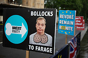 Poster lampooning Nigel Farage and the Brexit Party with his head pasted onto cartoon testicles in London, England, United Kingdom.