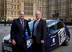 © Licensed to London News Pictures. 25/09/2012. LONDON, UK. Stephen Hammond, Parliamentary Under-Secretary of State for Transport (L), and Paul Kerr, the father of a car crash victim are seen outside Westminster as they launch the Peugeot Student Road Safety Awards today (25/09/12). The competition, aimed at 11-18 year olds, is designed to encourage students from schools, colleges and youth groups to create unique projects to raise awareness of road safety in a suitable way for young people. The awards were created by Paul Kerr after the death of his 17 year old son, who was killed in a car crash involving a driver who was just 18 years old. Photo credit: Matt Cetti-Roberts/LNP