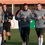 NLD/Katwijk/20110321 - Training Nederlandse Elftal Hongarije - NLD, warming up, Joris Mathijssen, Ibrahim Affalay, John Heitinga