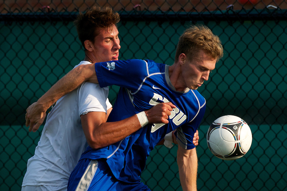 Catamounts defenseman Salvatore Borea (15) fights fro the ball during the men's soccer game between the Central Connecticut State University Blue Devils and the Vermont Catamounts at Virtue Field on Friday afternoon September 7, 2012 in Burlington, Vermont.