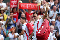 Roger Federer acknowledges the crowd after beating Dusan Lajovic on day four of the Wimbledon Championships at The All England Lawn Tennis and Croquet Club, Wimbledon.