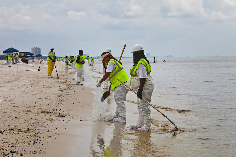 Oil clean up crews on the beach in Gulf Port ,Mississippi. Oil from the BP oil spill reached the beaches of Mississippi at the end of June 2010.