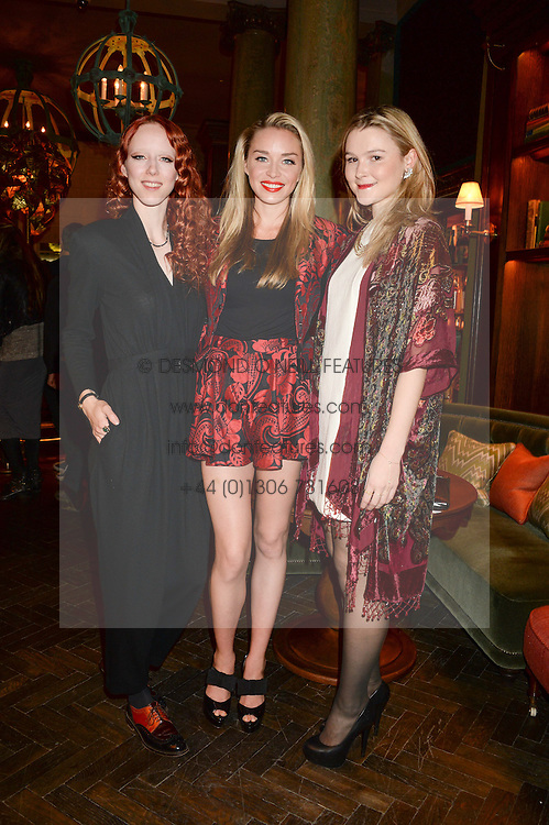 Left to right, MORWENNA LYTTON COBBOLD, NOELLE RENO and AMBER ATHERTON at the launch of Rosewood London - a new luxury hotel at 252 High Holborn, London WC1 on 30th October 2013.