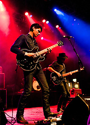 © Licensed to London News Pictures. 22/05/2012. London, UK. White Denim perform live at HMV Forum, London.  White Denim is a four-piece rock band from Austin, Texas. Their music draws influence from dub, psychedelic rock, blues, punk rock, progressive rock, soul, jazz, experimental rock with home-based recording, jamming approach, intense looping work and unusual song structures.  In this picture L to R - Austin Jenkins, Steve Terebecki.  Photo credit : Richard Isaac/LNP