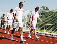 Photo: Chris Ratcliffe.<br />England Training Session. FIFA World Cup 2006. 13/06/2006.<br />Theo Walcott and David Beckham arrive for training.