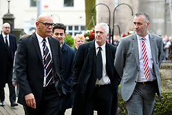Retired footballer George Berry (left) and Comedian Nick Hancock (centre) arrive at the funeral service for Gordon Banks at Stoke Minster.