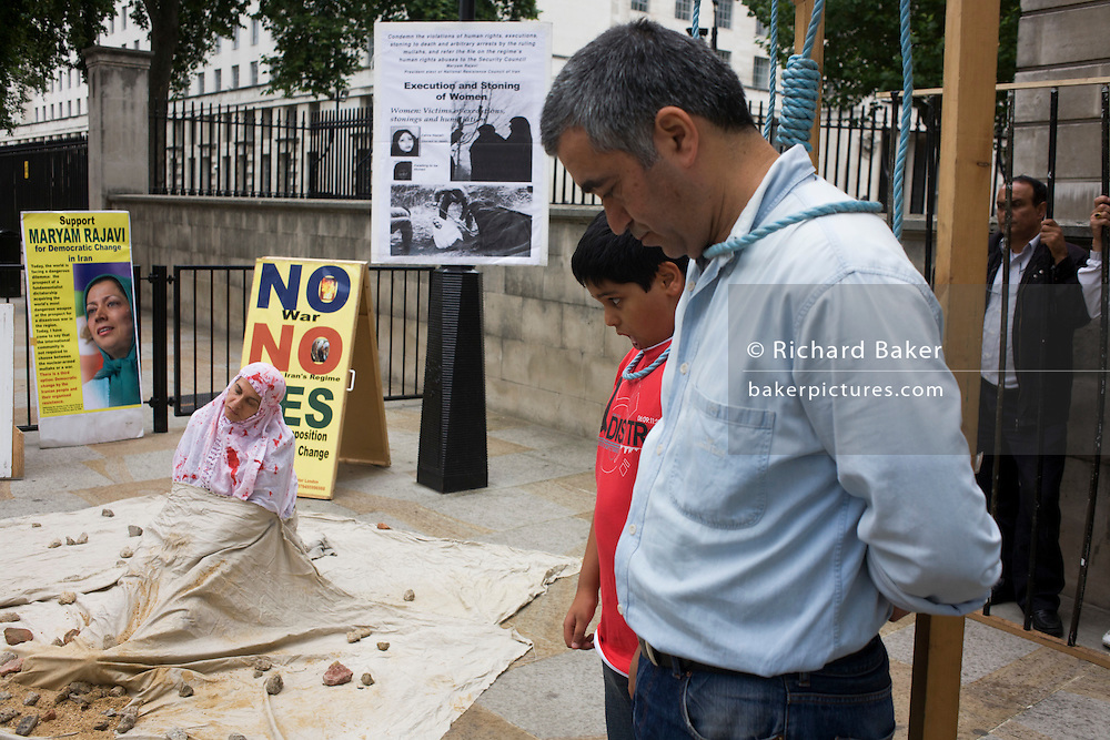 Anti-Iranian protesters show the government's policy of political executions. Seen in Whitehall, central London.