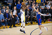 Golden State Warriors forward Kevin Durant (35) shoots a three pointer against the LA Clippers at Oracle Arena in Oakland, Calif., on January 10, 2018. (Stan Olszewski/Special to S.F. Examiner)