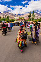 Buddhists walking to attend a teaching by His Holiness the 14th Dalai Lama at Choglamsar, Ladakh, Jammu and Kashmir State, India.