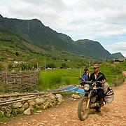 Vietnamese man criging a motorbike a road  at Northern Vietnam