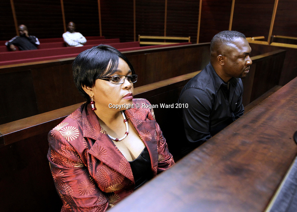 Sheryl Cwele and her co-accused Frank Nabolisa sit in the dock of the Pietermaritzburg High Court, 12 October, 2010. Cwele, wife of the Minister of State Security Siyabonga Cwele and Nabolisa, a Nigerian national, are currently on trial for dealing or conspiring to deal in drugs, drug trafficking and recruiting drug mules . © Rogan Ward 2010. © Rogan Ward 2010