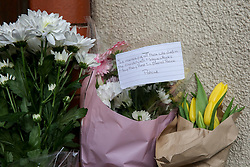 © Licensed to London News Pictures. 15/03/2019. London, UK. Floral tributes are left at the main entrance of Finsbury Park Mosque, in north London following Christchurch attack, in New Zealand in which 49 people died following a shooting at two mosques and a man in his late twenties has been charge with murder.  Photo credit: Dinendra Haria/LNP