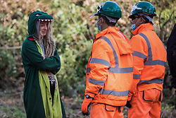 Denham, UK. 29th September, 2020. Security guards working on behalf of HS2 Ltd block an environmental activist objecting to the felling of trees in Denham Country Park for works connected to the HS2 high-speed rail link. Anti-HS2 activists based at the nearby Denham Ford Protection Camp and protesting against the destruction of the woodland contend that the area of Denham Country Park currently being felled is not indicated for felling on documentation supplied by HS2 Ltd.