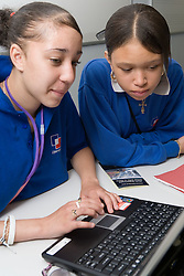 Students looking up information on  the internet during music lesson,