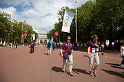 People come to soak up the atmosphere at Horse Guards Parade and the Mall, which was home to many events during the London 2012 Olympics Games. Volunteers.
