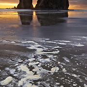 The western sun sets behind sea stacks on Second Beach in La Push, Washington.
