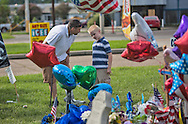 Glynes Hyde with her son Eric at a makeshift memorial in Baton Rouge in front of
