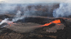 Handout photo of KÄ«lauea Volcano — Spatter Cone. Activity at fissure 6 this morning (May 25, 2018). Lava fountains have built a small spatter cone (black mound) from which lava was spilling out onto the surface and flowing into a small pond (left of the cone). Photo by USGS via ABACAPRESS.COM