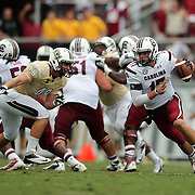 DUPLICATE***South Carolina Gamecocks quarterback Dylan Thompson (17) scrambles from UCF Knights defensive lineman Blake Keller (48) during an NCAA football game between the South Carolina Gamecocks and the Central Florida Knights at Bright House Networks Stadium on Saturday, September 28, 2013 in Orlando, Florida. (AP Photo/Alex Menendez)