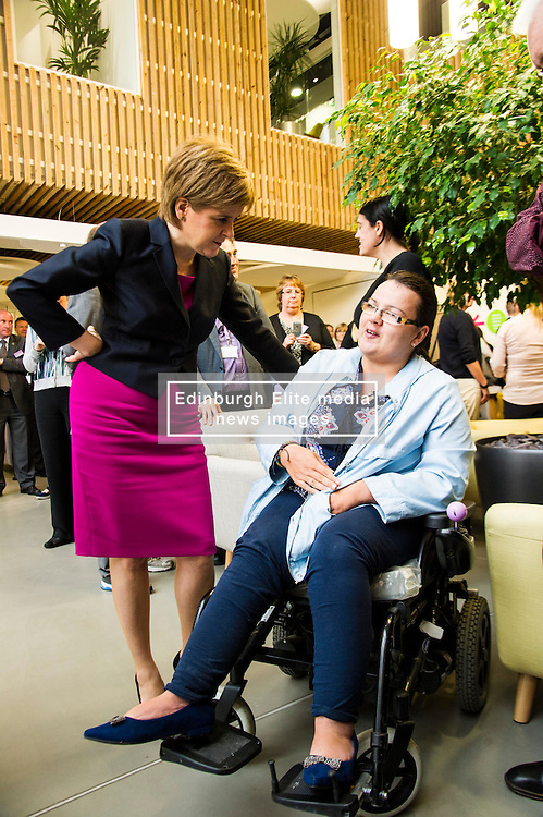 Pictured: Nicola Sturgeon and Karen Sutherland<br /> <br /> The First Minister Nicola Sturgeon, MSP, joined people supported by the Thistle Foundation to bury a time capsule to mark the opening of a new health and social care centre. <br /> Ger Harley | EEm 14 June 2016