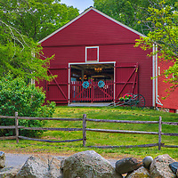 Rural Massachusetts landscape photography of a beautiful country  red old barn and New England farmstand at the Wayside Inn Historic District in Sudbruy, MA.<br /> <br /> Wayside Inn Historic District Red Old Barn photography images are available as museum quality photography prints, canvas prints, acrylic prints, wood prints or metal prints. Fine art prints may be framed and matted to the individual liking and decorating needs:<br /> <br /> https://juergen-roth.pixels.com/featured/wayside-inn-historic-district-red-old-barn-juergen-roth.html<br /> <br /> Good light and happy photo making!<br /> <br /> My best,<br /> <br /> Juergen