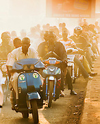 Thousands of people ride in the mornings on their mopeds, a time called Moped Mania, in Bamako, Mali