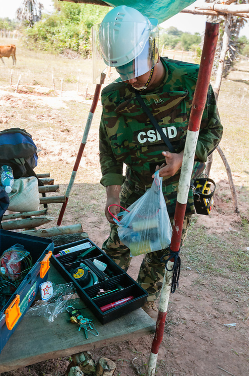 Land mine clearing - packing explosives,  Cambodia