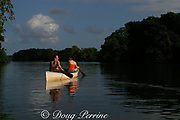 ecotourists canoeing on Sittee River, Belize, Central America, MR 313, 314