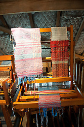 New Zealand, North Island, near Wellington, sheep wool production displays of shearing, spinning, weaving, and products at The Wool Shed in Wairarapa. Photo copyright Lee Foster. Photo # newzealand125764