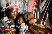 Niamassaka Akizou, 40, a mother of eight, sits with her child inside the home where she has found refuge in Goma, Eastern Democratic Republic of Congo on Monday December 15, 2008. Akizou and her family have been here for two months, after violence forced them to flee their home in Rutshuru, 70km north of Goma.