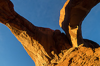 The first sunlight of the day shines on Double Arch. This is the view directly underneath the 104 foot arch, looking straight up.<br /> <br /> Date Taken: 11/8/2013