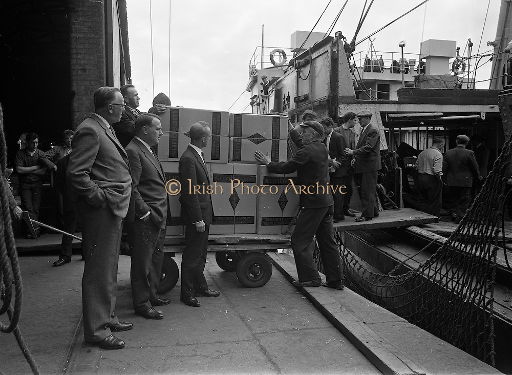 01/08/1962<br /> 08/01/1962<br /> 01 August 1962 <br /> Loading Sunbeam Jerseywear  onto ship at B and I North Wall, Dublin.<br /> Image shows boxes about to be loaded on the ship at the quay.