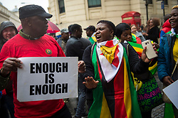 Zimbabweans gather outside the Zimbabwe Embassy in London, to demonstrate in support of the ousting of President Robert Mugabe.