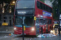 © Licensed to London News Pictures.  12/07/2021. London, UK. Piles of rubbish left behind football supporters in central London as England lost to Italy on penalties during yesterday's EURO 2020 final. Photo credit: Marcin Nowak/LNP